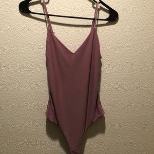 pink spaghetti strap body suit